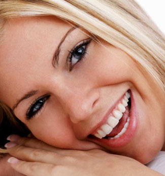 smiling person with veneers
